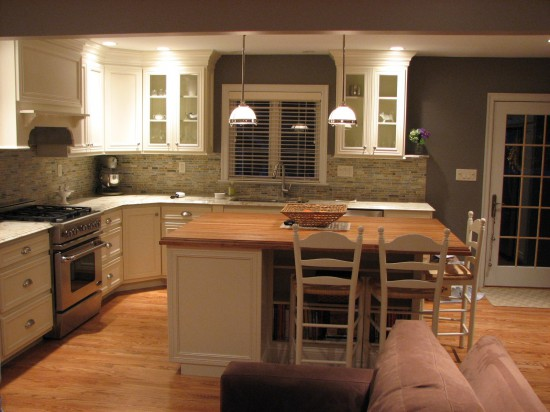 Ivory white cabinets with cherry island top